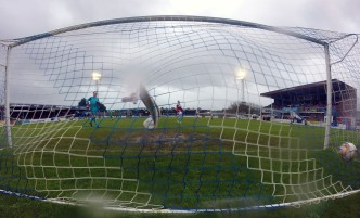 Left of picture Weymouth player manager Jason Matthews can only look on as Matt Lench's drive hits the back of his net in the rain at the Bob Lucas Stadium. https://idrismartin.wordpress.com/