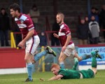 Jonny McNamara goes to ground after making contact with Terras defender Dean Evans in the penalty box at the Bob Lucas Stadium, but the ref waved away his penatly appeals.