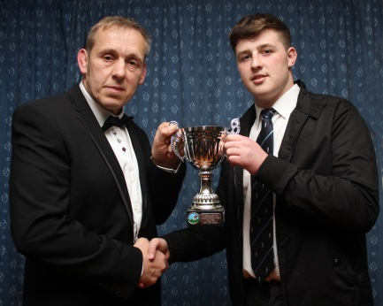 Club head coach Paul (Pablo) Harding (left) presents the Most Improved Player of the Year Cup to Josh Cameron.