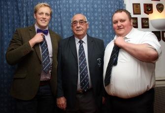 Clhairman Ian McMikkan (centre) presents 100 games ties to Tim Comben (right) & ?. https://idrismartin.wordpress.com/
