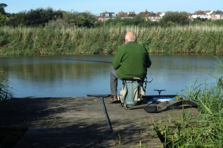 Weymouth & Portland this morning.. An angler hopes for a bite at Radipole Lake RSPB Nature Reserve in Weymouth. https://idrismartin.wordpress.com/
