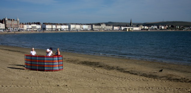 Weymouth & Portland this morning.. A family stake out their territory on Weymouth's golden sands early this morning. https://idrismartin.wordpress.com/