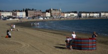 Weymouth & Portland this morning. A family stake out their territory on Weymouth's golden sands early this morning.