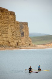 West Bay Dorset. With the temperature in the high 20's it's time to cool off on a paddle board with the Jurassic Coast as a back drop. https://idrismartin.wordpress.com/