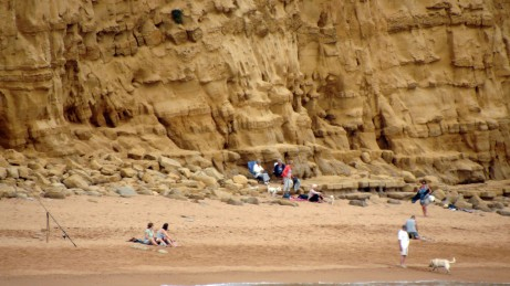 West Bay Dorset. With the temperature in the high 20's these visitors to the Jurassic Coast decide to relax beneath the cliffs despite the evidence of recent rock falls. https://idrismartin.wordpress.com/