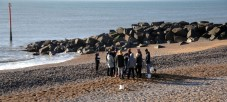West Bay Dorset on the Jurassic Coast Mid Morning. + 5 degrees C in the sun on the Jurassic Coast. Some students undertake an expermient on the beach. https://idrismartin.wordpress.com/