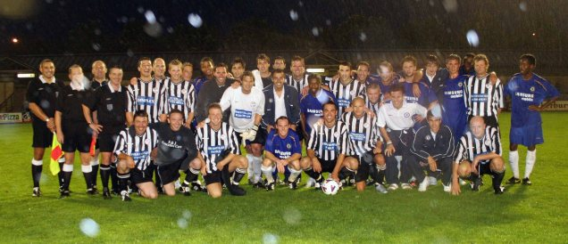 In the rain Andy centre with ball with his invitation team & the Chelsea side.