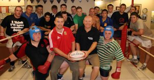 Front row Dorset & Wilts under 20 prop forwards Tim Comben left & twin brother Simon right with Weymouth director of rugby Dave Allan centre left & fittness coach Mark Ford with some of the club's first team squad at Weymouth Amateur Boxing Club.