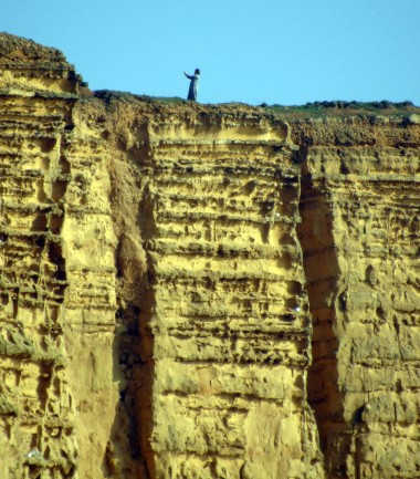 Dicing With Death. Not the place to grab a selfie pearched on top of a cliff where recent falls are obvious this woman seems oblivious to the risk of the ground below her feet giving way and launching her 300 feet into the sea on the Jurassic Coast at West Bay Dorset https://idrismartin.wordpress.com/
