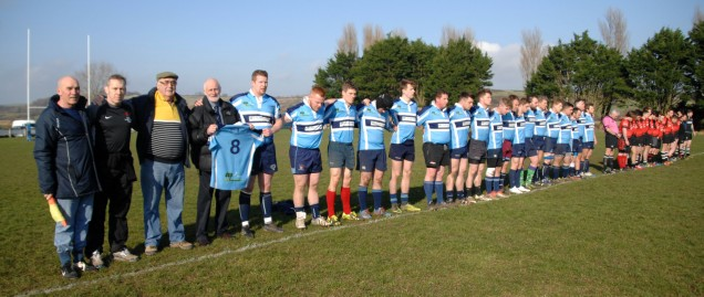 Before the home game against Sherborne seconds Weymouth & Portland rugby club president Des Quick father of Julian & first team captain Ryan Lewendon hold the number 8 shirt that was worn by former captain Julian Quick who sadly passed away 2 weeks ago at the age of 28 following a long battle with cancer during a minutes silence observed in Julian's memory. https://idrismartin.wordpress.com/