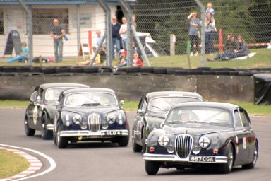 HRDC Coombs Heritage Trust competitor Peter Dorlin in his 1961 Mk 2 Jaguar 15 leads the way around Quarry Corner on Sunday. https://idrismartin.wordpress.com/