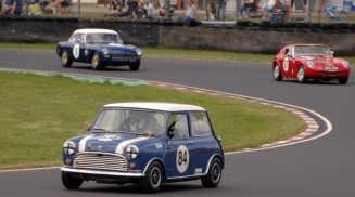 HRDC Allstars /ACD/ASC winner Steve Jones in his 1965 Mini Cooper S 84 with eventual second places local driver John Moon in his 1958 Lenham 57 both round Quarry Corner on Sunday.