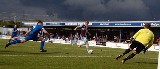 Terras winger Charlie Davis strokes the ball past Chippenham keeper Jared Thompson for the Terras opener.