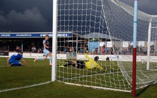 Storm Clouds Gather for The Bluebirds. Terras winger Charlie Davis strokes the ball past Chippenham keeper Jared Thompson for the Terras opener. https://idrismartin.wordpress.com/