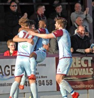 Calvin Brooks is mobbed by his team mates after netting the Terras opener. https://idrismartin.wordpress.com/