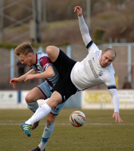 Is this a tackle or an assault Terras sub Harry Baker feels the full force of Town's Sam Gaughran. Referee Alexander Fisher dismissed Gaughran for this dangerous tackle. https://idrismartin.wordpress.com/